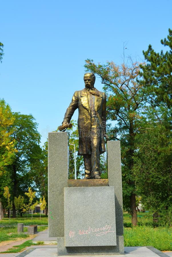 Monument to Taras Grigorievich Shevchenko in full growth, 12 meters and a green square. Beautiful monument on hillside overlooking the Samara River in the stock photo
