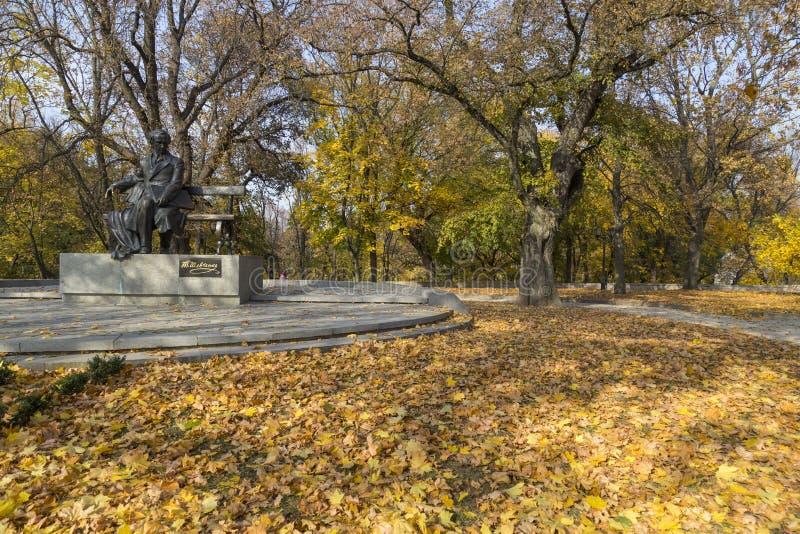 Monument to Taras Shevchenko among the fallen leaves. Chernihiv city.Ukraine royalty free stock photo