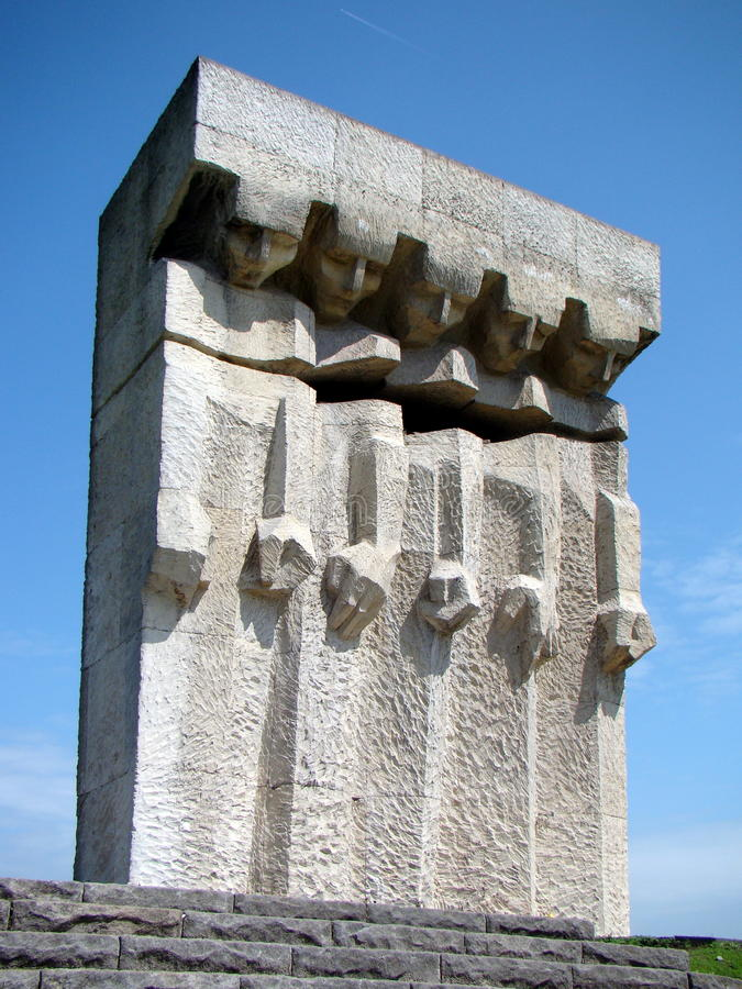 Monument to the Victims of Fascism in Krakow. Massive granite monument towers over Kamienskiego street, one of Krakow's busy arteries, on the southern edge of stock image