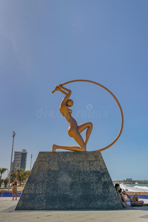 Monument to Women Fortaleza Brazil. FORTALEZA, BRAZIL, DECEMBER - 2015 - People at monument dedicated to woman, a modern sculpture located at iracema beach in royalty free stock image
