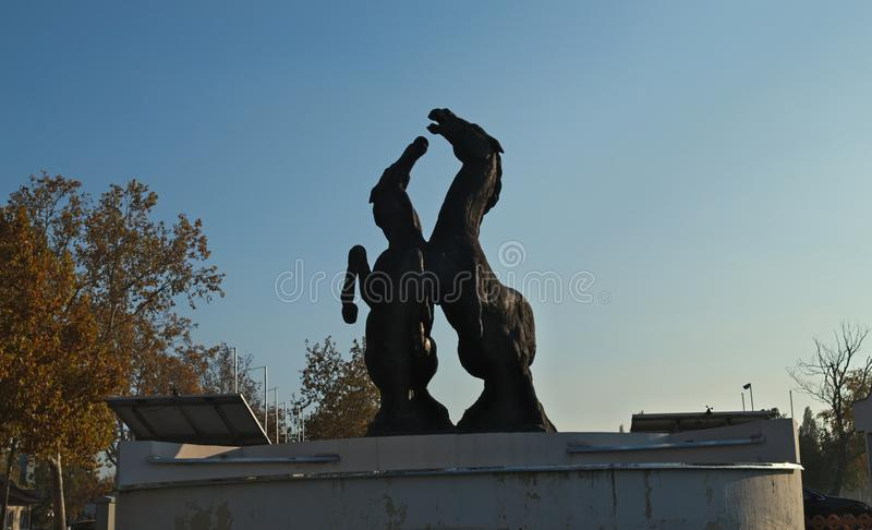 Monument of two horses standing on back legs.  stock images