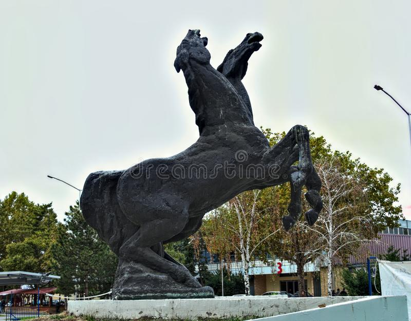 Monument of two horses, trees and sky in background.  royalty free stock photography