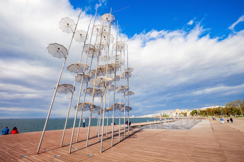 Monument Umbrellas in Thessaloniki. THESSALONIKI, GREECE - OCTOBER 12, 2016: The sculpture Umbrellas by George Zongolopoulos are located at the New Beach in stock photos