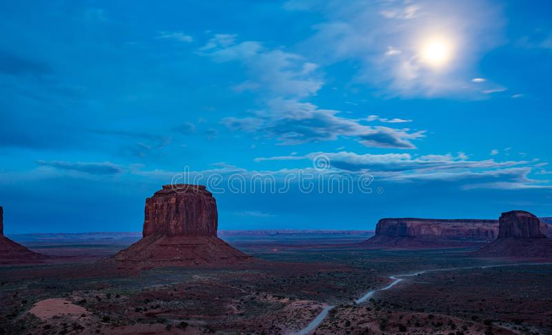 Monument Valley Tribal Park in the Arizona-Utah border, USA. Monument Valley, Fullmoon in spring. Red rocks against blue sky in the evening. Navajo Tribal Park stock photography