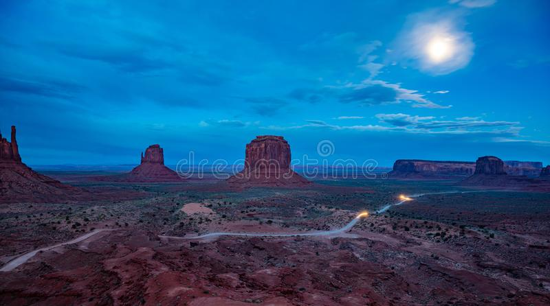 Monument Valley Tribal Park in the Arizona-Utah border, USA. Monument Valley, Fullmoon in spring. Red rocks against blue sky in the evening. Navajo Tribal Park stock image