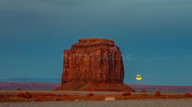 Monument Valley Tribal Park in the Arizona-Utah border, USA. Monument Valley, Fullmoon in spring. Red rocks against blue sky in the evening. Navajo Tribal Park royalty free stock photography