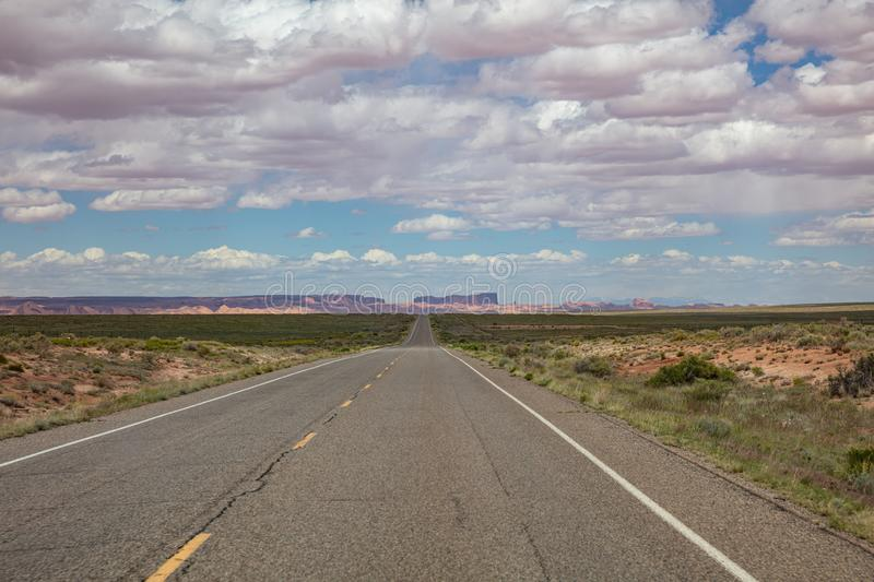 Monument Valley highway, Tribal Park in the Arizona-Utah border, USA. Monument Valley road, Navajo Tribal Park in the Arizona-Utah border, United States of royalty free stock image