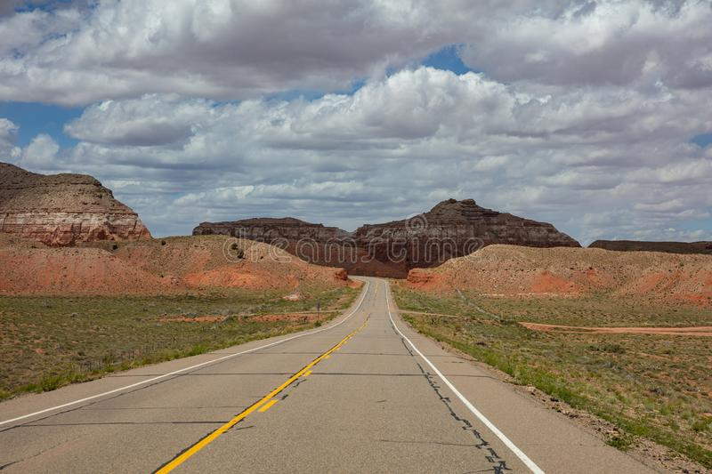 Monument Valley highway, Tribal Park in the Arizona-Utah border, USA. Monument Valley road, Navajo Tribal Park in the Arizona-Utah border, United States of stock photography