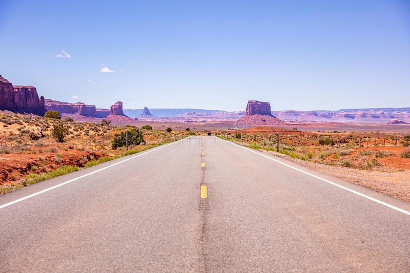 Monument Valley highway, Tribal Park in the Arizona-Utah border, USA. Monument Valley road, Navajo Tribal Park in the Arizona-Utah border, United States of stock photo