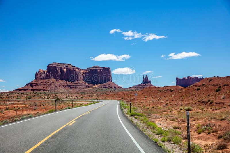 Monument Valley highway, Tribal Park in the Arizona-Utah border, USA. Monument Valley road, Navajo Tribal Park in the Arizona-Utah border, United States of royalty free stock images