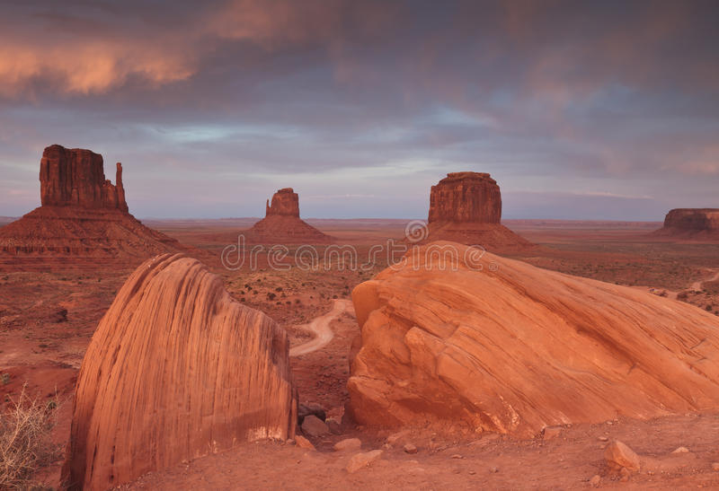 Monument Valley landscape. Scenic view of butte rock formations in Monument Valley at sunset viewed from Navajo Indian Reservation Tribal Park, Arizona and Utah royalty free stock photo