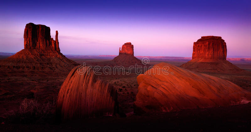 Monument Valley Landscape with Purple Skies andRed Rock Formations. At Sunset stock photography