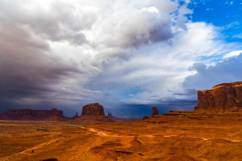 Monument Valley landscape after thunderstorm. Iconic Monument Valley, Navajo Nation, Utah landscape with dramatic clouds after thunderstorm royalty free stock photo