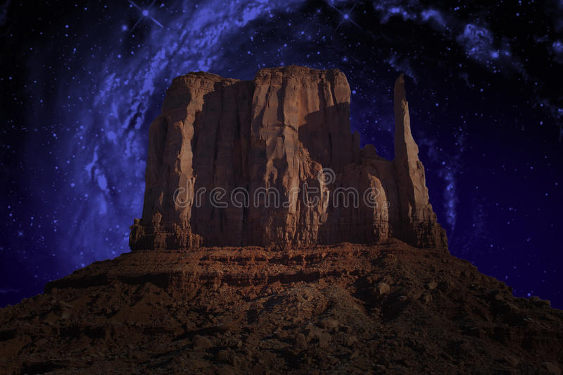 Monument Valley, Milky Way, Stars. Illustration of the West Mitt or Mitten in Monument Valley. the night sky stars and Milky Way shine in the outer space of the stock photos