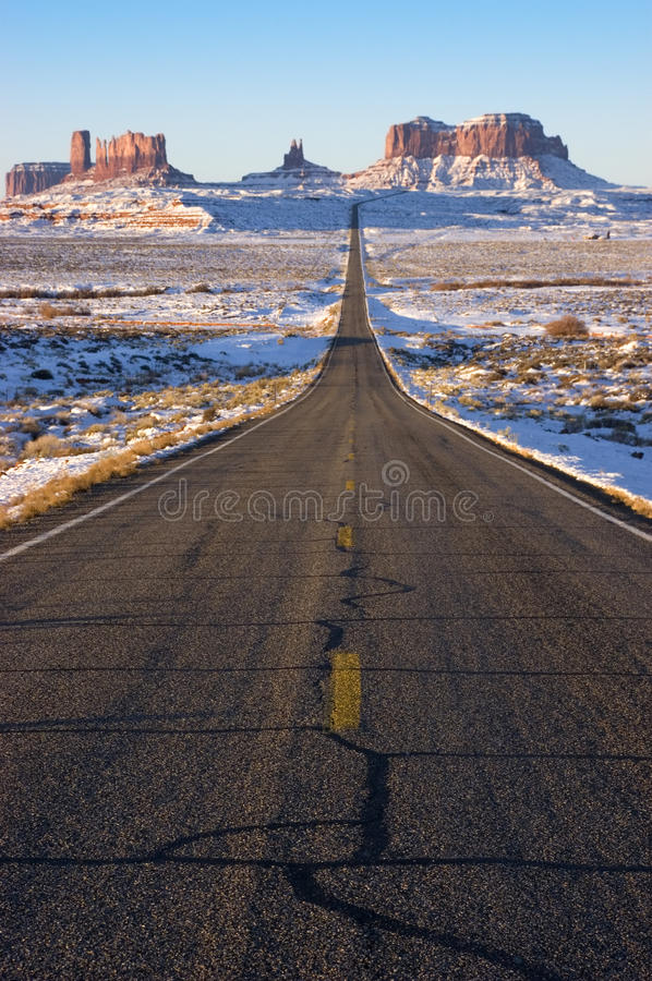 Monument Valley Navajo Indian Tribal Park Approach. Road leading into Monument Valley Navaho Indian Reservation Tribal Park. You've seen this image many times stock image
