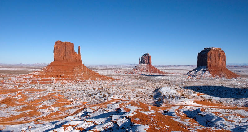 Monument Valley Navajo Indian Tribal Park, Winter. View of the West and East Mitten buttes at the Monument Valley Navajo Indian Reservation Tribal Park. Many royalty free stock photos