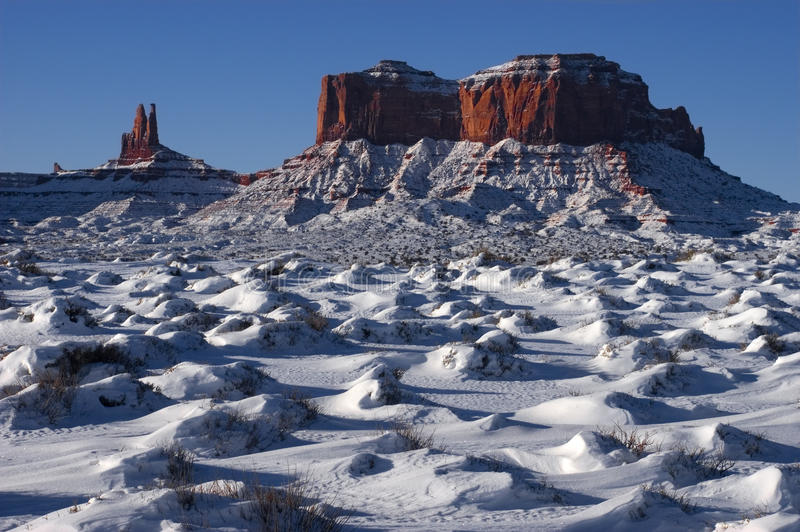 Monument Valley Navajo Indian Tribal Park, Winter. View of some buttes at the Monument Valley Navajo Indian Reservation Tribal Park. Many John Ford western stock photo