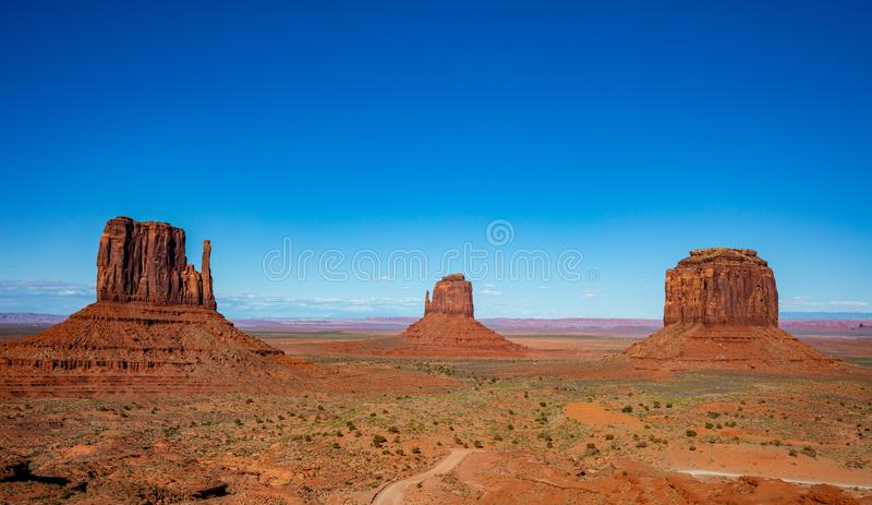 Monument Valley Tribal Park in the Arizona-Utah border, USA. Monument Valley, Navajo Tribal Park in the Arizona-Utah border, United States of America. Red rocks royalty free stock photos