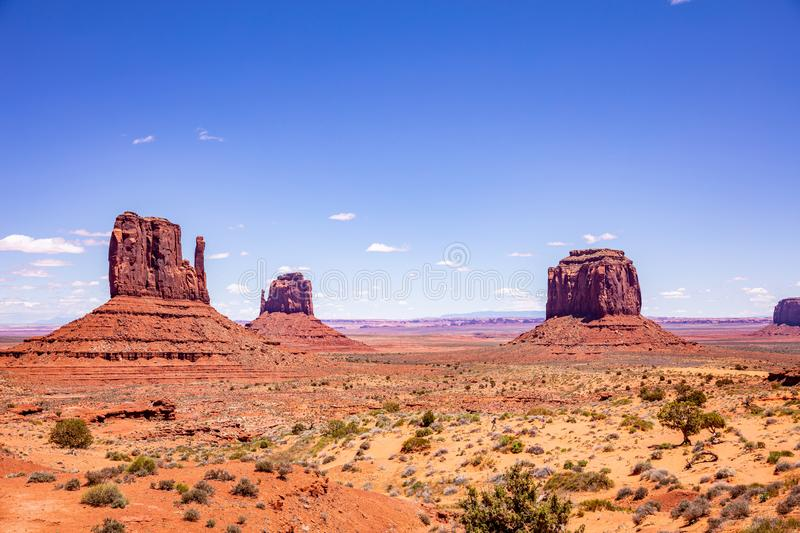 Monument Valley Tribal Park in the Arizona-Utah border, USA. Monument Valley, Navajo Tribal Park in the Arizona-Utah border, United States of America. Red rocks royalty free stock images