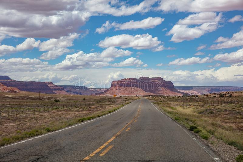 Monument Valley highway, Tribal Park in the Arizona-Utah border, USA. Monument Valley road, Navajo Tribal Park in the Arizona-Utah border, United States of royalty free stock photography