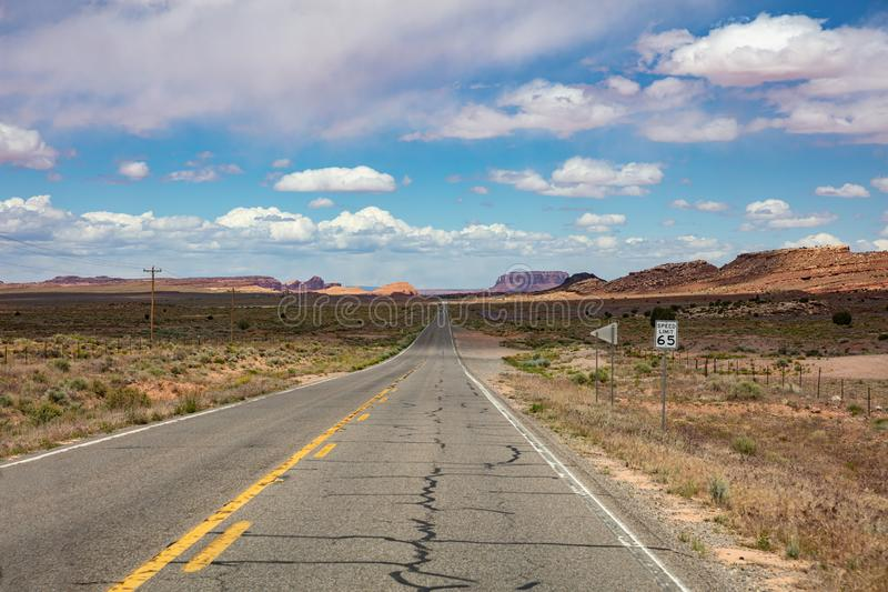 Monument Valley highway, Tribal Park in the Arizona-Utah border, USA. Monument Valley road, Navajo Tribal Park in the Arizona-Utah border, United States of royalty free stock photo