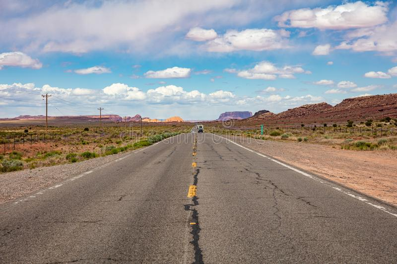 Monument Valley highway, Tribal Park in the Arizona-Utah border, USA. Monument Valley road, Navajo Tribal Park in the Arizona-Utah border, United States of stock photos