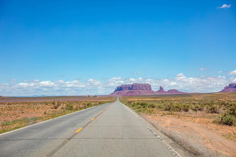 Monument Valley highway, Tribal Park in the Arizona-Utah border, USA. Monument Valley road, Navajo Tribal Park in the Arizona-Utah border, USA. Scenic highway to stock photo