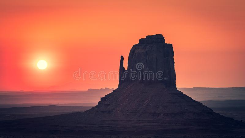 Sunrise behind the East Mitten, Monument Valley royalty free stock photo