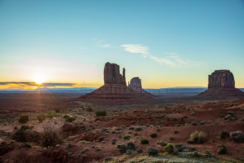 Sunrise at Monument Valley Tribal Park in the Arizona-Utah border, USA. Monument Valley at sunrise. Navajo Tribal Park in the Arizona-Utah border USA. Sun rising stock photos