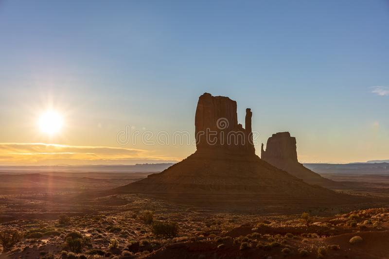 Sunrise at Monument Valley Tribal Park in the Arizona-Utah border, USA. Monument Valley at sunrise. Navajo Tribal Park in the Arizona-Utah border USA. Sun rising stock image