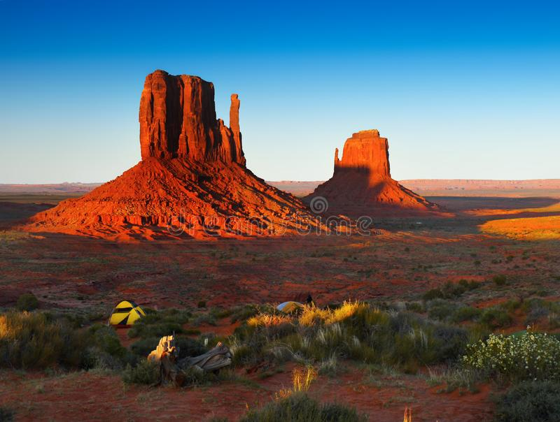 Monument Valley, Desert Landscape Sunset, American Southwest. Scenic desert landscape and rocks - buttes at sunset. Monument Valley Navajo Tribal Park. American stock photo