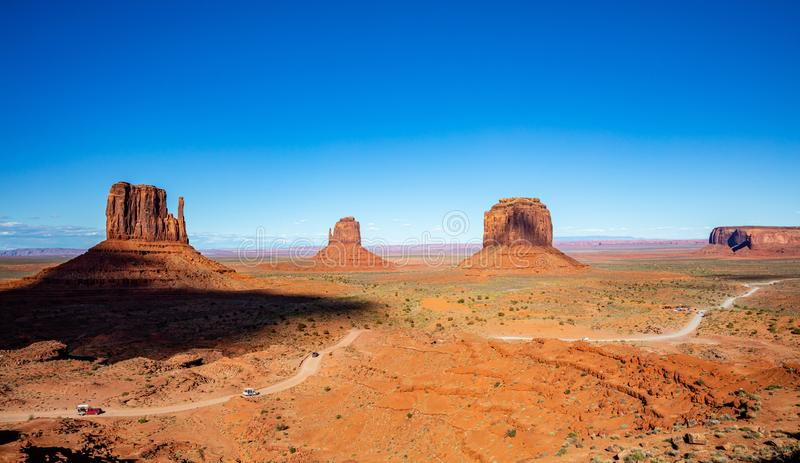 Monument Valley Tribal Park in the Arizona-Utah border, USA. Monument Valley, Navajo Tribal Park in the Arizona-Utah border, United States of America. Red rocks stock photo