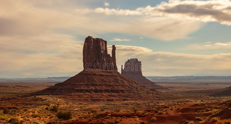 Monument Valley Tribal Park in the Arizona-Utah border, USA. Monument Valley under the Fullmoon light in spring. Red rocks against blue sky in the evening royalty free stock photography