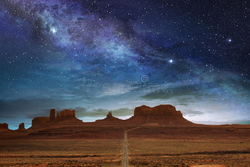 The monument valley under a night starry sky royalty free stock photography