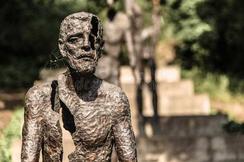 Monument victims of communism. Man fragment with spiderweb in prague in summer daylight stock images