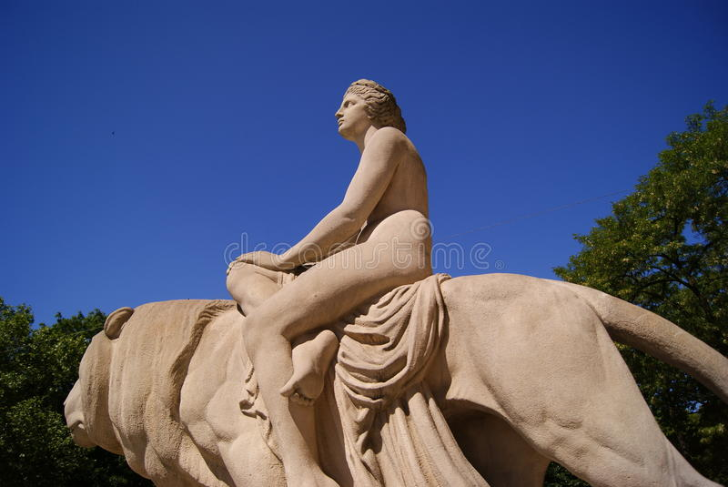 The monument of woman sitting on a lion stock image