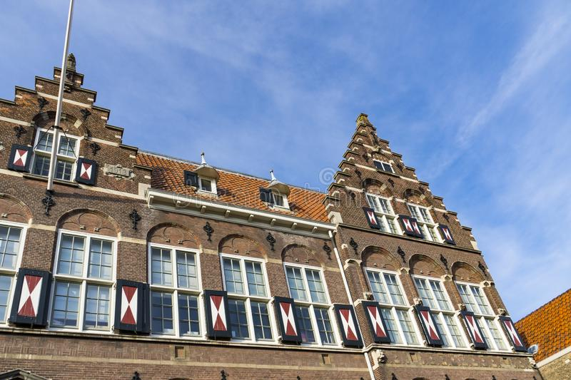 Old school in Hofstraat Dordrecht, The Netherlands. Monumental building, old school with stepped gable and shutters, in Hofstraat, Dordrecht, The Netherlands stock photography