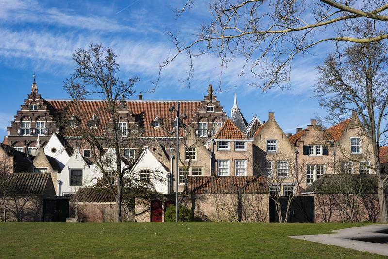 Monumental buildings in street Kloostertuinen, Dordrecht, The Netherlands. Street Kloostertuin with monumental buildings and school in Dordrecht, The Netherlands royalty free stock image