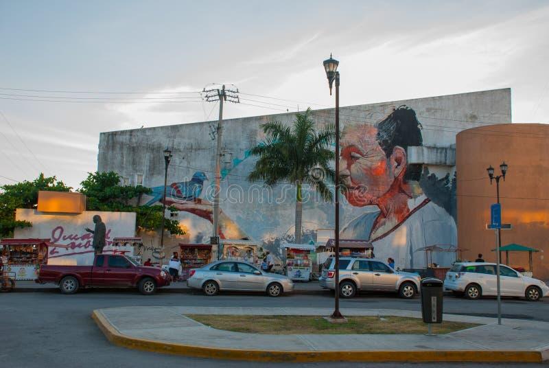 Monumento e graffiti sulla parete di una costruzione nella città Campeche, disegno un uomo sul suo mano che una colomba si siede  fotografie stock