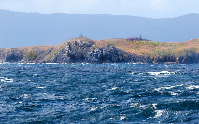 Monumento en el cabo de Hornos con el mar tempestuoso Tierra del Fuego Province, Chile 3d ilustración tridimensional muy hermosa, fotos de archivo libres de regalías