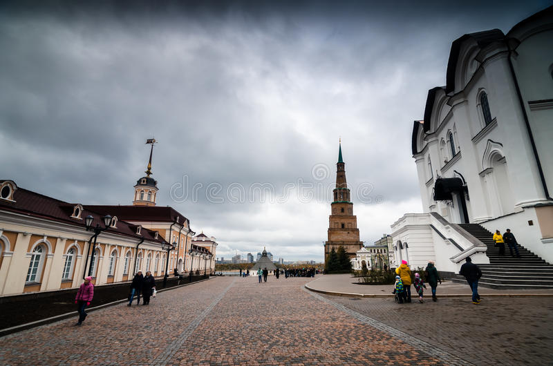 Monuments of ancient complex. Pedestrian streets between monuments in old Kazan Kremlin with tourists walking around royalty free stock photos