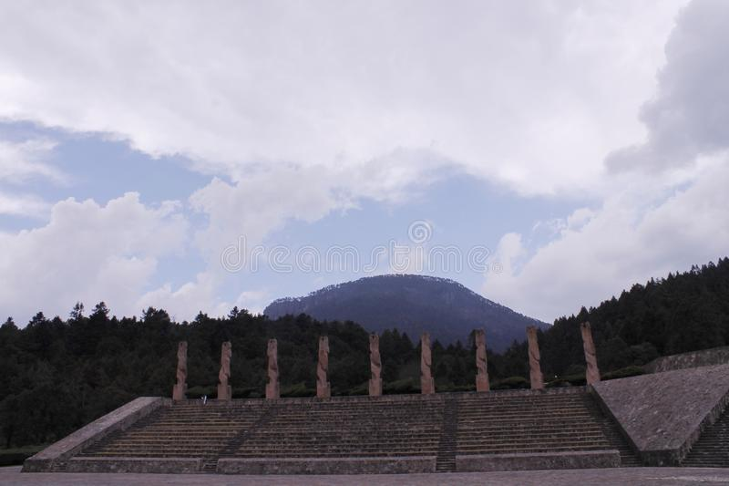 Monuments at the top of the stairs, Centro Ceremonial Otomi in Estado de Mexico. This monuments at the top of the stairs and benches are located at one side of royalty free stock photo
