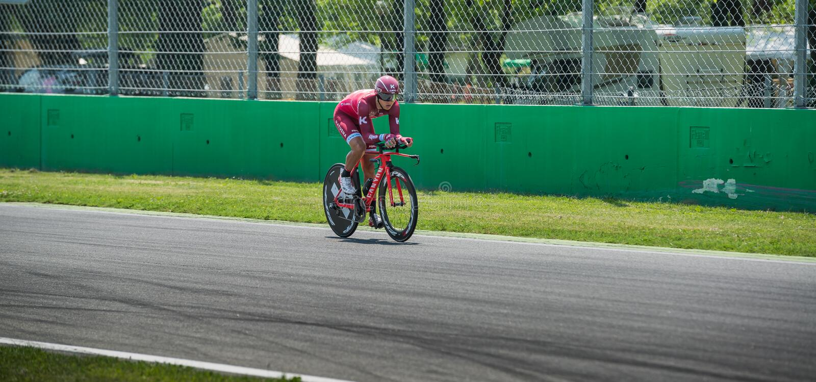 Monza, Italy May 28, 2017: Professional cyclist, Katusha Team, during the last time trial stage of the Tour of Italy 2017. With a lap of the Formula 1 circuit stock photography