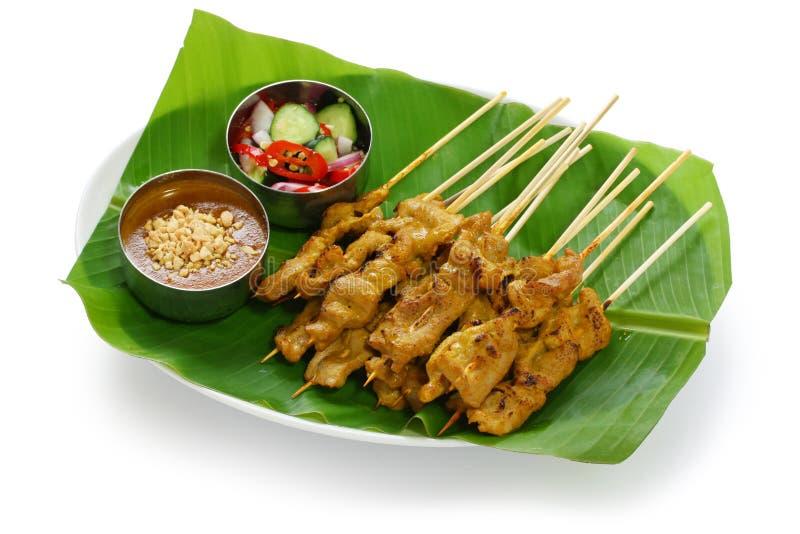 MOO satay, cerdo satay, cocina tailandesa imagen de archivo