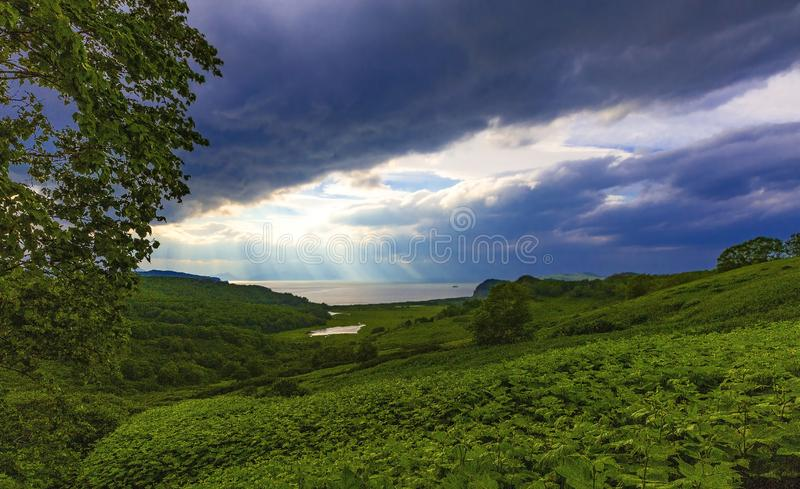 The moody and atmospheric image with  view of the lake and clouds with sun rays. Moody and atmospheric image with  view of the lake and clouds with sun rays royalty free stock photo