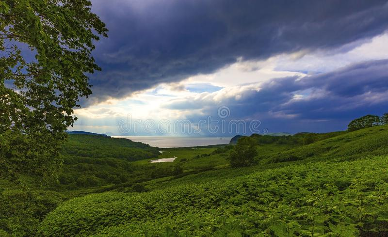The moody and atmospheric image with  view of the lake and clouds with sun rays. Moody and atmospheric image with  view of the lake and clouds with sun rays royalty free stock photography