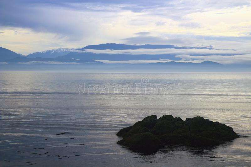 East Sooke Park, Vancouver Island, British Columbia, Canada - Moody Autumn Day along Juan de Fuca Strait with Olympic Mountains. Southern Vancouver Island royalty free stock image
