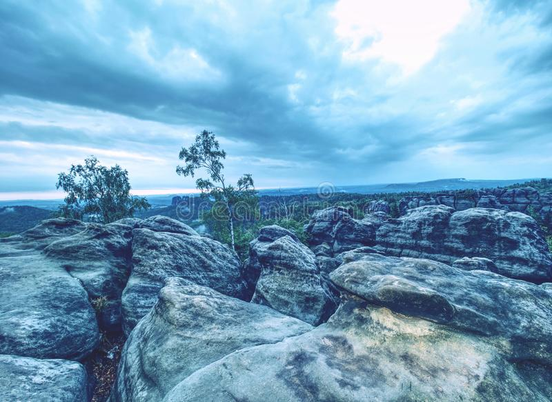 Moody dreamy sunset on top of rocky mountain royalty free stock photography