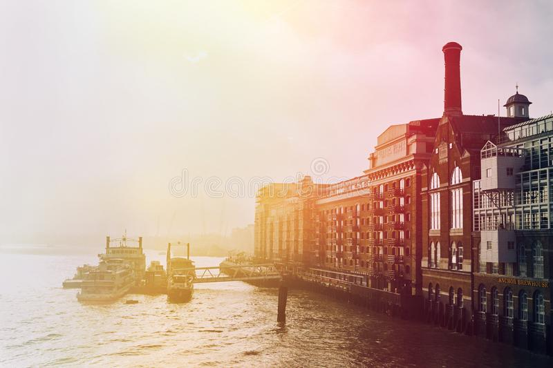 Moody image of Butler`s Wharf. Moody colour image of Butler`s Wharf in London, UK. Shot from Tower Bridge royalty free stock photo