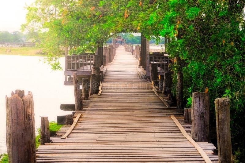 Moody image of old textured wooden boardwalk, Ubein bridge, Amarapura, Myanmar. Burma stock images